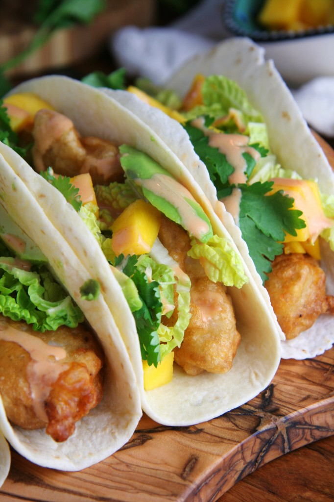 Beer battered fish tacos with mango avocado sriracha for How to cook fish tacos
